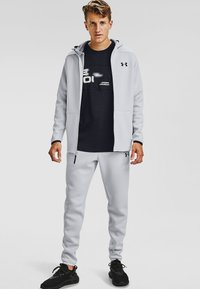 Under Armour - MOVE PANTS - Tracksuit bottoms - halo gray - 0