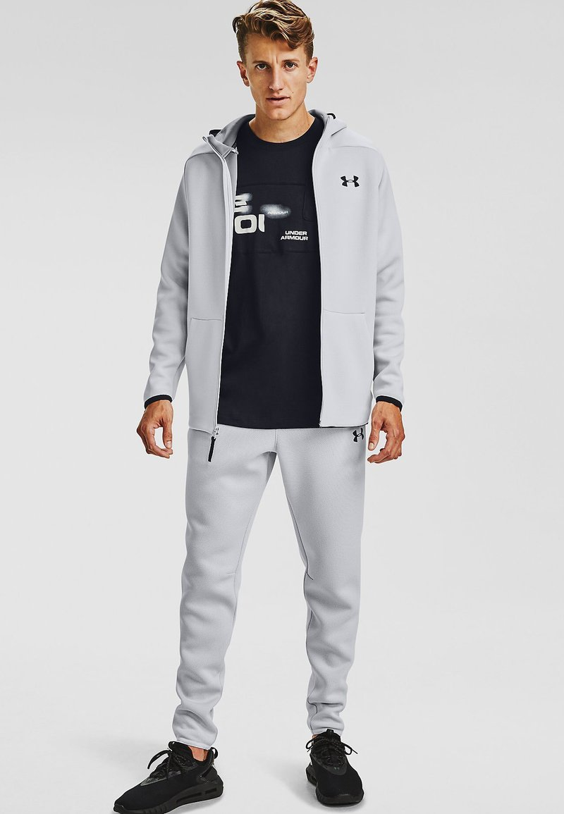 Under Armour - MOVE PANTS - Tracksuit bottoms - halo gray