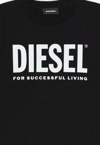 Diesel - JUSTLOGO MAGLIETTA - Print T-shirt - nero - 3