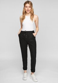 QS by s.Oliver - REGULAR FIT - Trousers - black - 1