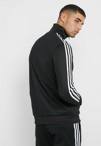 adidas Originals - BECKENBAUER UNISEX - Chaqueta de entrenamiento - black - 2