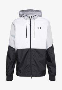 Under Armour - FIELD HOUSE JACKET - Waterproof jacket - white/black - 4