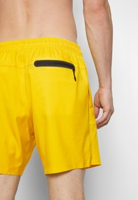 Puma - SWIM MEN MEDIUM LENGTH - Swimming shorts - yellow - 1