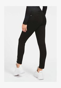 Guess - Jeans Skinny Fit - schwarz - 2