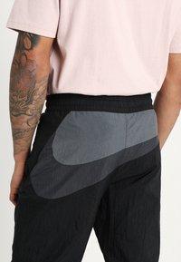 Nike Sportswear - WOVEN PANT - Tracksuit bottoms - black/anthracite/dark grey - 6