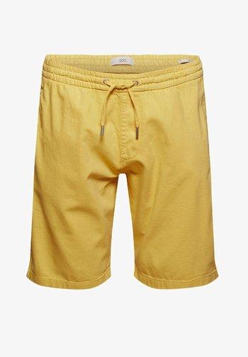 Tracksuit bottoms - light yellow