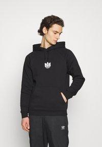 adidas Originals - TREFOIL HOOD UNISEX - Sweatshirt - black - 0