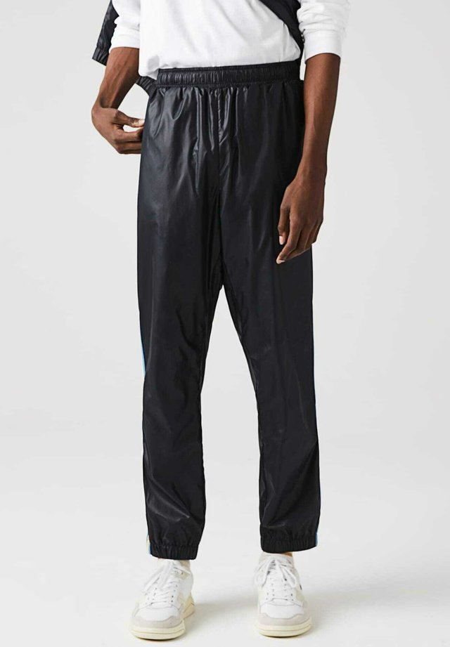 Pantalon de survêtement - navy blau / blau / weiß / gelb