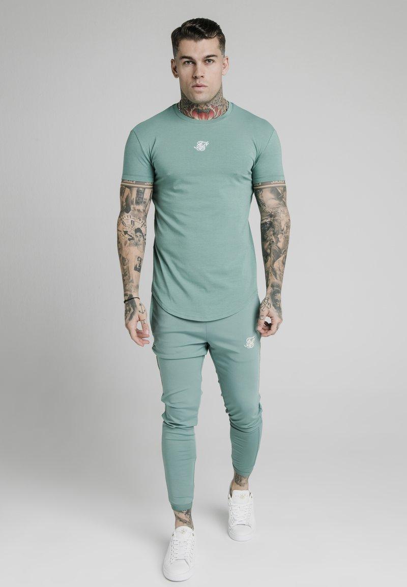 SIKSILK - Basic T-shirt - light petrol blue