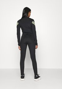 adidas Originals - SWAROVSKI STAGE SUIT - Jumpsuit - black - 2
