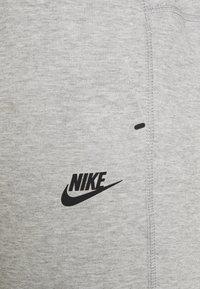 Nike Sportswear - Tracksuit bottoms - grey heather - 4