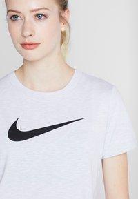 Nike Performance - DRY TEE CREW - Print T-shirt - white/black - 4
