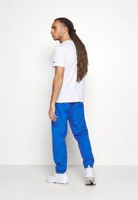 Champion - ELASTIC CUFF PANTS - Tracksuit bottoms - blue - 2
