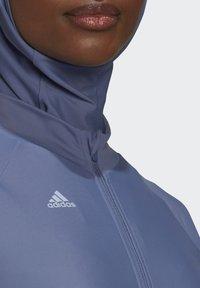adidas Performance - ADI PBSW TOP SWIM SPORTS WATERSPORTS PRIMEBLUE NYLON RASH GUARD - Long sleeved top - purple - 5