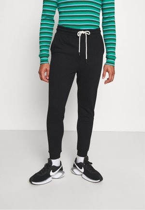TRIPPY SLIM TRACKIE - Tracksuit bottoms - peached black