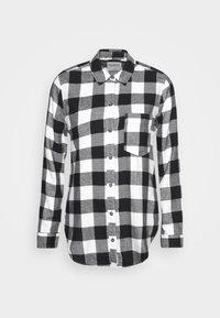 HOLIDAY - Button-down blouse - white/black