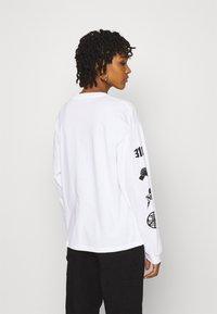 Carhartt WIP - TAB - Long sleeved top - white/black - 2