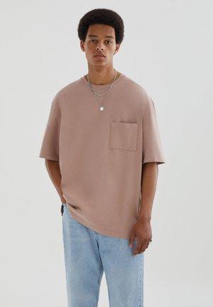OVERSIZE AUS PREMIUM-GEWEBE - Basic T-shirt - pink