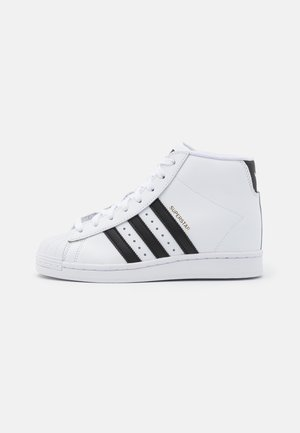 SUPERSTAR SPORTS INSPIRED MID SHOES - High-top trainers - footwear white/core black/gold metallic