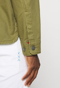 Tommy Jeans - CARGO JACKET - Summer jacket - uniform olive - 3