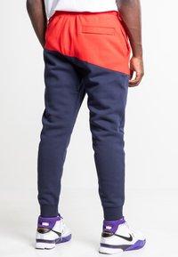 Nike Sportswear - Træningsbukser - university red/obsidian/white - 2