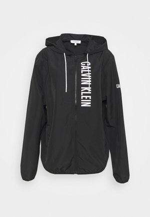 WINDBREAKER - Light jacket - black