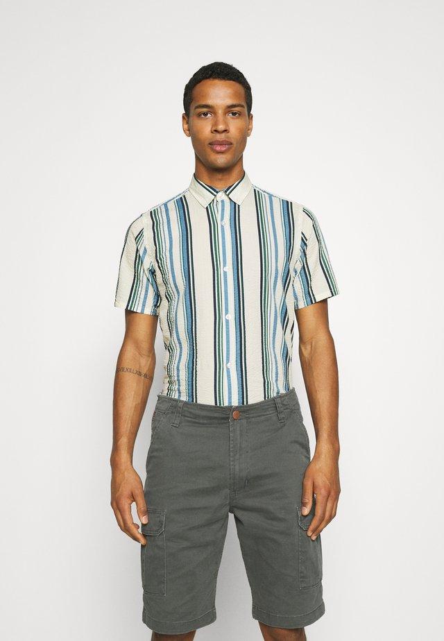 STRIPE - Skjorte - blue/off-white