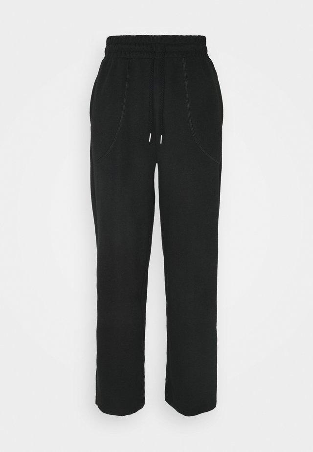 HER WIDE PANTS - Træningsbukser - puma black