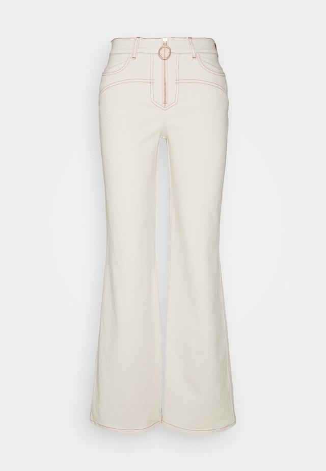 Jeans a zampa - buttercream