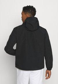 Calvin Klein - OVERHEAD FRONT LOGO ANORAK - Tunn jacka - black - 2