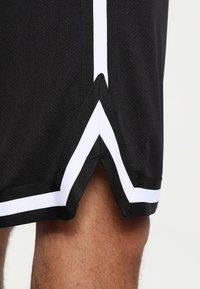 Urban Classics - STRIPES - Pantalon de survêtement - black/black/white - 4