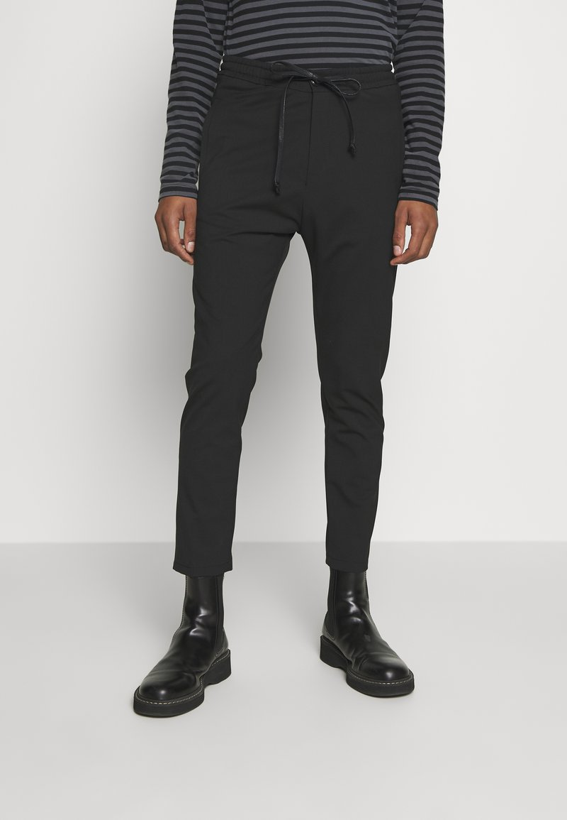 DRYKORN - JEGER - Trousers - black