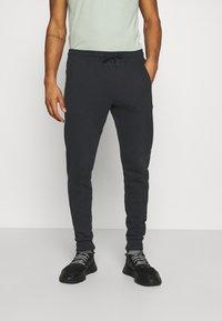 Calvin Klein Jeans - MONOGRAM - Tracksuit bottoms - black - 0