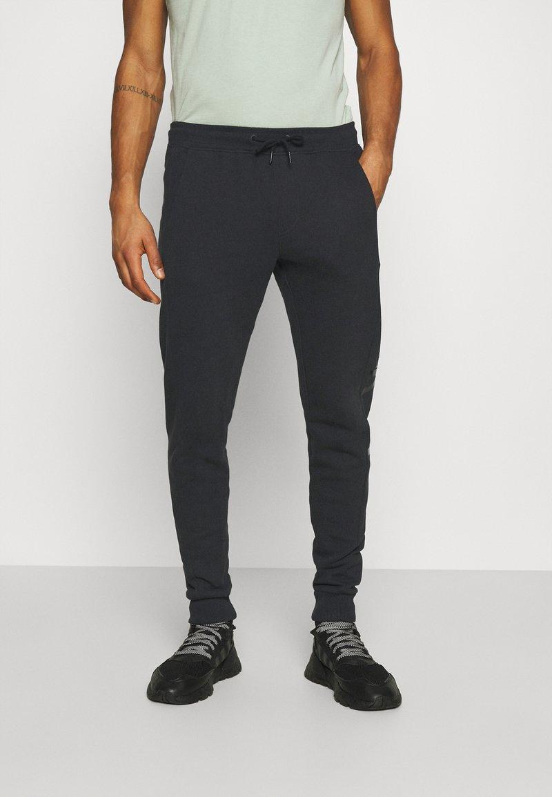 Calvin Klein Jeans - MONOGRAM - Tracksuit bottoms - black