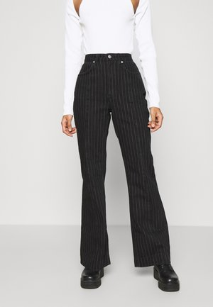 ORIAN TROUSERS - Flared jeans - black