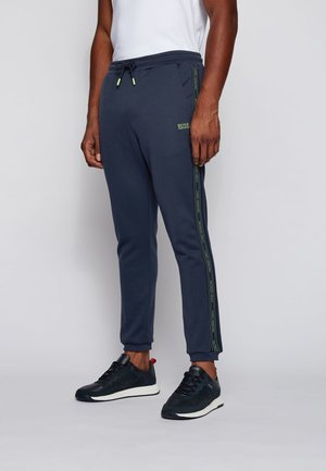 HADIKO ICON - Tracksuit bottoms - dark blue