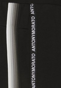 Antony Morato - TROUSERS SLIM FIT IN TERRY FABRIC WITH RUBBER - Tracksuit bottoms - black - 2