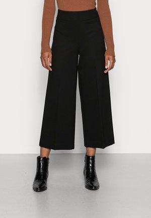 MISHA SOFT - Trousers - black