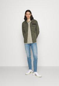 Replay - BRONNY X LITE - Slim fit jeans - medium blue - 1