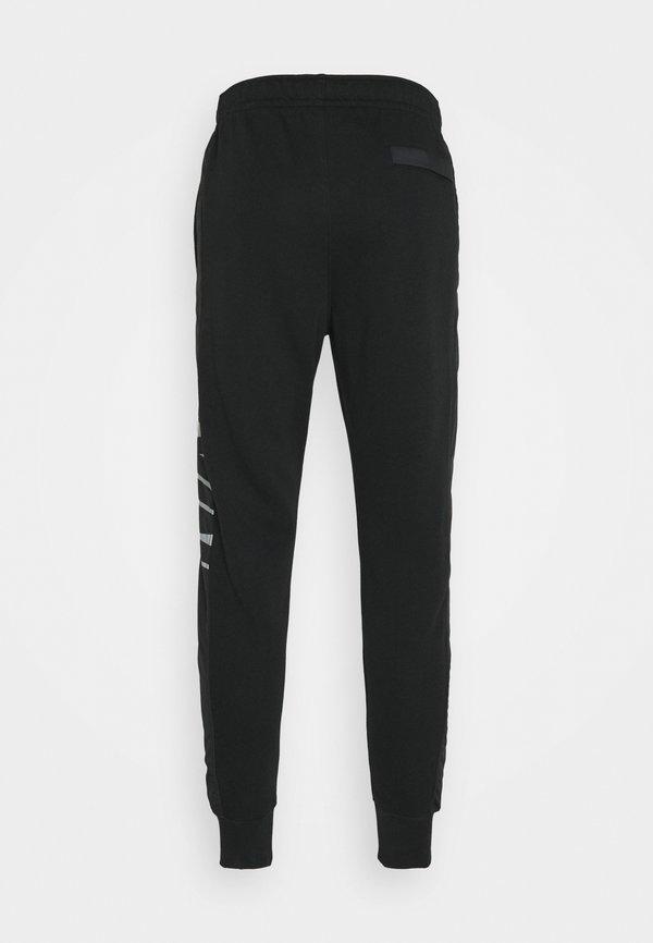 Nike Sportswear Spodnie treningowe - black/particle grey/white/czarny Odzież Męska QRYE