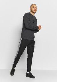 adidas Performance - TAN CREW - Mikina - grey - 1