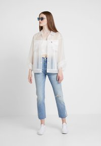 Levi's® - CLEAR BAGGY TRUCKERIN THE CLEAR - Regenjas - in the clear - 1