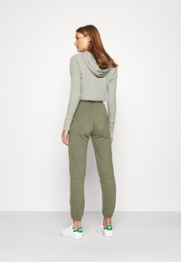 Abercrombie & Fitch - FALL TREND LOGO JOGGER - Tracksuit bottoms - olive - 2