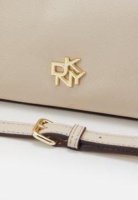 DKNY - CAROL MINI POUCHETTE - Handbag - eggshell - 3