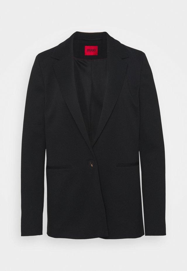 ANELAS - Halflange jas - black