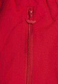 adidas Originals - SLICE TREFOIL ADICOLOR PRIMEGREEN ORIGINALS SLIM TRACK - Pantalones deportivos - scarlet/crew blue - 5