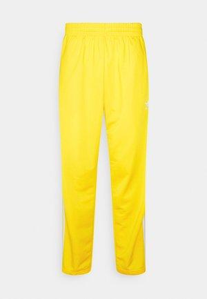 FIREBIRD UNISEX - Träningsbyxor - yellow