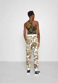 Versace Jeans Couture - PANTS - Tracksuit bottoms - white/gold - 2
