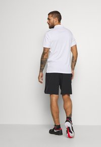 Nike Performance - ACE SHORT - Pantalón corto de deporte - black/white - 2
