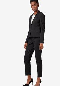 BOSS - TILUNA - Trousers - black - 1